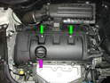 (Mk2 Cooper) Remove the two Torx screws (green arrows) and the oil filler cap (purple arrow).
