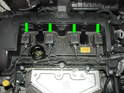 (Mk2 Cooper) Remove spark plug cover panel and flip metal tabs up (green arrows) to release electrical connection.