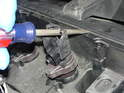 (Mk2 Cooper) Use a screwdriver to pry the coil pack up and off the spark plug.