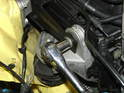 Remove the 16mm bolt at the front of the engine mount brace.