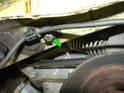 Remove the E12 Torx bolt underneath the passenger side engine mount.