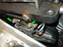 (R50 Cooper) On the Cooper models, the belt tensioner is a different design; however you will need to follow all of the steps in removing the passenger side engine mount in order to access the tensioner.
