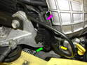 Begin by removing the fuel tank vent valve directly above the belt tensioner and supercharger pulley.