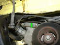 With the tire and wheelhouse liner removed, you'll see the dampening strut for the tensioner right in front of you.
