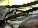 Shown here are the two bolts that secure the dampening strut to the tensioner assembly.