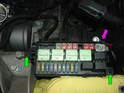 Now remove the two 8mm screws holding the fusebox to the chassis (green arrows).