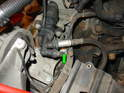 (R50 Cooper): As shown here, the slave cylinder must be removed in order to access one of the mounting bolts for the transmission mount on the R50 Cooper (green arrow).