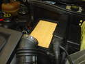 Remove the upper air filter housing and the air filter is right underneath.