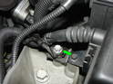 Remove the 10mm bolt securing the wiring harness to the front of the lower airbox.