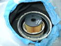 Place the new filter element inside the filter housing and push it down as far as it will go.