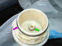 Place the new O-rings both inside the filter housing and also the top cover (green arrow).