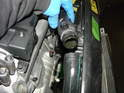 Use a large pair of pliers to release the hose clamps on the upper hose.