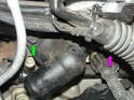 The thermostat housing bolts also hold the MAP sensor bracket to the cylinder head.
