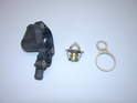 Shown here is a new thermostat, gasket and housing.