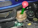 Use a turkey baster or large syringe to siphon out the coolant inside the old tank.