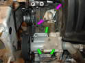 Remove the two 10mm bolts holding the water pump flange to the engine block (purple arrows), then remove the three 13mm bolts holding the water pump to the engine block (green arrows).
