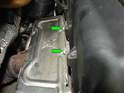 Remove the two 13mm bolts securing the exhaust manifold heat shield to the cylinder head.