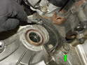 Remove the two 10mm bolts holding the cover shield just below the starter and remove the cover.