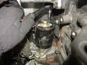 Remove the upper mounting bolt for the starter.