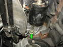 Now remove the lower mounting bolt holding the starter.