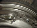 Shown here is a close-up of one of the E8 Torx bolts that hold the pressure plate to the flywheel.