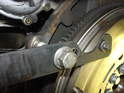 You'll want to lock the flywheel to remove the bolts holding the flywheel to the engine.