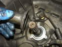 Remove the shaft seal cover/guide tube and you will see the input shaft seal directly underneath.