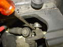 Remove the shift cables from the transmission by prying them up and off.