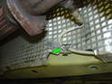 Remove the oxygen sensor wiring from the two clips holding it to the heat shield (green arrow).