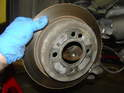 For the rear discs on the MINI, you don't need to remove the caliper mounting frame.
