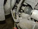 ThisPicture shows the upper caliper guide bolt being removed.