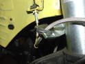 Press the rubber grommet on the new brake line into the bracket on the side of the strut.