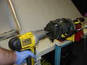Use an impact wrench to quickly zap the top nut off the assembly once the spring compressors are installed.