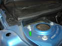 ThisPicture shows the location of the camber pin (green arrow) on the upper front strut mount of the later R55/R56/R57 MINI Cooper and Cooper S.
