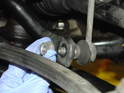 Shown here is the lower sway bar connection with the 16mm nut removed.