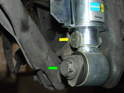 Next, line up the large lower shock bolt with the hole in the wheel carrier, thread it in and torque it to 140nM (103 ft/lbs.