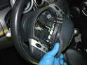 Loosen the two Torx bolts and then carefully remove the airbag from the wheel.