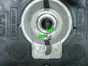 With the center bolt removed, you can see the alignment marks on both the wheel and the steering shaft (green arrows).