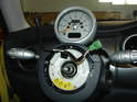 Now pull the steering wheel off the steering shaft and carefully route the wiring through the hole in the steering wheel.