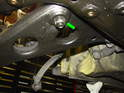 Now move underneath the car and remove the large nut securing the inner ball joint to the control arm.