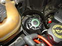 As you lower the subframe, pay attention to the power steering reservoir.