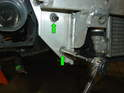 After removing the front bumper cover, remove the bolts and nuts securing the bumper carrier to the front of the car, then remove the two nuts on each side of the carrier to free it from the subframe crush tubes (green arrows) NOTE: Passenger side shown, driver's side is similar.