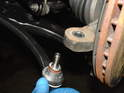 Fit the new tie rod end into the steering knuckle.