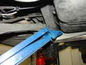 Now use the floor jack to jack the rear subframe back up into position on the rear of the car.