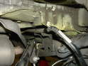 Shown here is the sway bar being pulled over the subframe mounting flange.