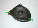 ThisPicture shows a strut mount removed from the car with the two mounting studs removed (green arrows).