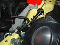 Shown here is the strut installed with the harness connector re-positioned into the extra hole.