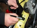 Hold the strut in place and use either a Sharpie or a permanent marker to mark the hole locations on the car.
