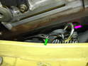Use the belt tensioner tool to release tension on the serpentine belt and lock the tensioner in place by inserting the factory pin or a small Allen wrench (purple arrow) into the second hole in the tensioner arm (green arrow).