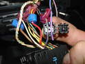 Look at the wiring harness going to the radio and find the purple wire with blue stripe.